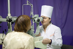 Ophthalmologist  and patient testing  eyesight Stock Photo