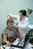Ophthalmologist  and patient testing  eyesight Royalty Free Stock Photography