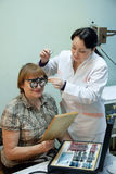 Ophthalmologist  and patient testing  eyesight Stock Images