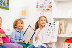 Ophthalmologist testing patient's sight with card Royalty Free Stock Image