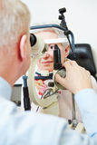 Ophthalmologist using slit lamp Stock Photography