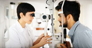 Ophthalmology concept. Patient eye vision examination in ophthalmological clinic. Ophthalmology concept. Patient eye vision examination in eyesight Stock Images