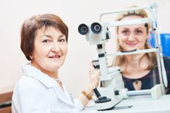 Ophthalmology. female doctor portrait with patient stock images