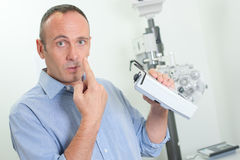 Ophthalmology pointing at eye Royalty Free Stock Image