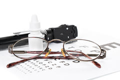 Ophthalmoscope, eye test and glasses Stock Photo