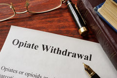 Opiate withdrawal written on a paper. Stock Image