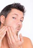 opieki mężczyzna skóra Obraz Royalty Free