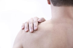 Opieki zdrowotnej i problemu pojęcie - nieszczęśliwy mężczyzna cierpienie od szyi lub ramię bólu w domu Fotografia Stock