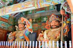 Opiekunów demony przy bramami Buddyjska Sinheungsa świątynia Obrazy Stock