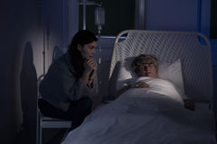 Opiekunu obsiadanie pacjentem Zdjęcie Royalty Free