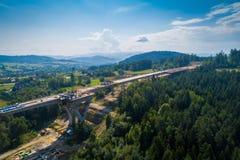 Opinião aérea do zangão na construção da estrada Fotografia de Stock