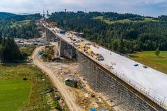 Opinião aérea do zangão na construção de estradas Fotos de Stock Royalty Free