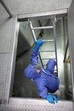 Opinião aérea o especialista que vai acima uma escada fotografia de stock royalty free