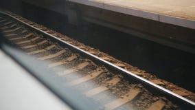 Opinião abstrata de trilhas de estrada de ferro da janela movente rápida do trem video estoque