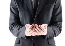 Opinião colhida o homem de negócios no terno com mãos abertas Imagens de Stock