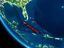 Opinião da órbita de Cuba na noite Fotos de Stock
