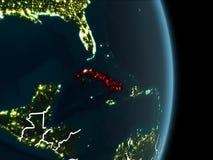 Opinião da órbita de Cuba na noite Fotografia de Stock Royalty Free