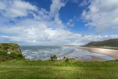 Opinião da baía de Rhossili, Gales do Sul, Reino Unido Imagens de Stock