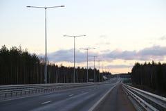 Opinião da noite da estrada no por do sol Fotografia de Stock Royalty Free