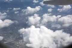 Opinião da nuvem do por do sol do avião imagens de stock royalty free