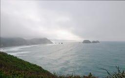 Opinião da rocha de três arcos do cabo Meares fotos de stock royalty free