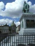Opinião da rua e da estátua, área de Royal Palace, Copenhaga, Dinamarca Foto de Stock