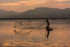 Opinião da silhueta do pescador Fotografia de Stock Royalty Free