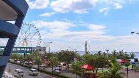 Opinião de Timelapse sobre a baía de Manila com roda da balsa filme