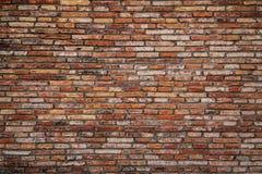 Opinião dianteira da textura áspera alaranjada da parede de tijolo Foto de Stock