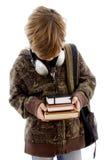 Opinião dianteira o menino com livros e auscultadores Fotos de Stock