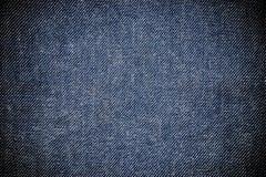 Opinião do close up para abstrair o espaço da textura vazia de calças de ganga imagem de stock