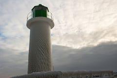 Opinião do farol da cabeça de Ventspils, Letónia do inverno Fotografia de Stock