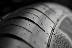 Opinião do macro do auto pneu Fotos de Stock