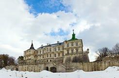 Opinião do panorama do castelo de Pidhirtsi da mola (Ucrânia) Fotografia de Stock
