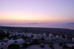Opinião do por do sol de Oia do console de Santorini imagem de stock