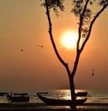 Opinião do por do sol em torno da fotografia da área da praia Foto de Stock Royalty Free