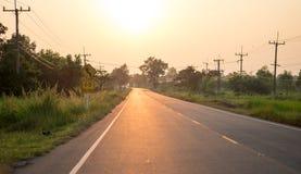 Opinião do por do sol na estrada Fotos de Stock