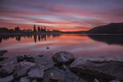 Opinião do por do sol no lago Tekapo Foto de Stock