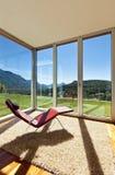 Opinião do quarto com uma cadeira Imagens de Stock