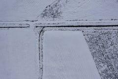 Opinião do zangão da terra nevado do inverno foto de stock