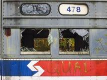 Opinião lateral abandonada de carros de trole com número da rota e as janelas quebradas Imagem de Stock