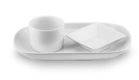 Opinião lateral da placa do prato da esfera no fundo branco Fotos de Stock