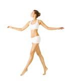 Opinião lateral de passeio da mulher, roupa interior do algodão da menina, pessoa no branco Imagens de Stock Royalty Free