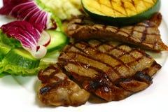 Opinião lateral grelhada da refeição do bife imagem de stock