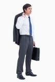 Opinião lateral o comerciante com mala de viagem e revestimento Imagens de Stock Royalty Free