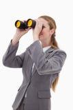 Opinião lateral o empregado do banco com spyglasses Fotografia de Stock