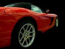 Opinião lateral vermelha de carro de esportes Fotografia de Stock Royalty Free
