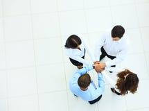 Opinião superior os executivos com suas mãos Imagem de Stock Royalty Free