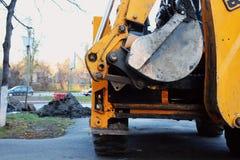 Opinião traseira da máquina escavadora com cubeta Imagem de Stock