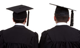 Opinião traseira dois graduados, isolada no branco Imagem de Stock Royalty Free